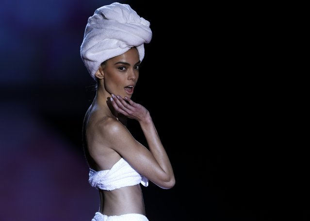 A model displays an outfit created by designer Andres Sarda's Fall/Winter 2015 collection during the Mercedes-Benz Fashion Week in Madrid February 7, 2015. (Photo by Javier Barbancho/Reuters)