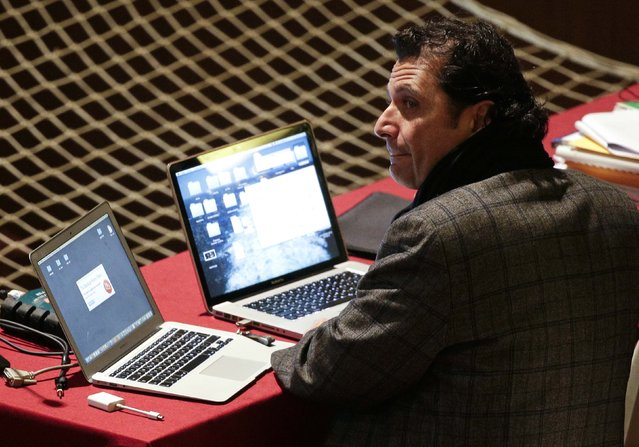 Captain of the Costa Concordia cruise liner Francesco Schettino sits with two laptops at court during his trial in Grosseto February 9, 2015. The trial of Schettino, accused of causing the deaths of 32 people in the 2012 Costa Concordia cruise ship disaster, nears its climax with a verdict expected over the coming days. (Photo by Max Rossi/Reuters)