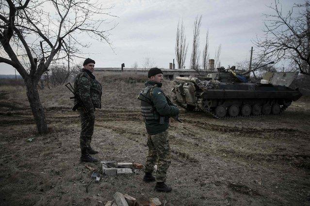 Ukrainian servicemen are pictured at their positions near Debaltseve, eastern Ukraine, February 8, 2015. (Photo by Gleb Garanich/Reuters)