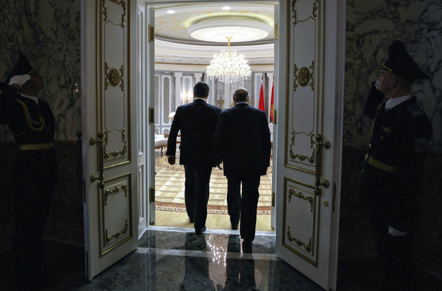 Belarus' President Alexander Lukashenko, right, and Ukraine's President Petro Poroshenko enter a hall in Minsk, Belarus, Wednesday, February 11, 2015. (Photo by Mykhailo Palinchak/AP Photo)