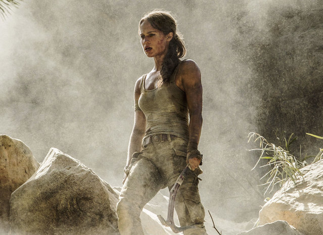 "This image released by Warner Bros. Pictures shows Alicia Vikander in a scene from ""Tomb Raider"". It took weeks of training and plates full of protein to turn former ballerina Alicia Vikander into action star Lara Croft. (Photo by Ilze Kitshoff/Warner Bros. Pictures via AP Photo)"