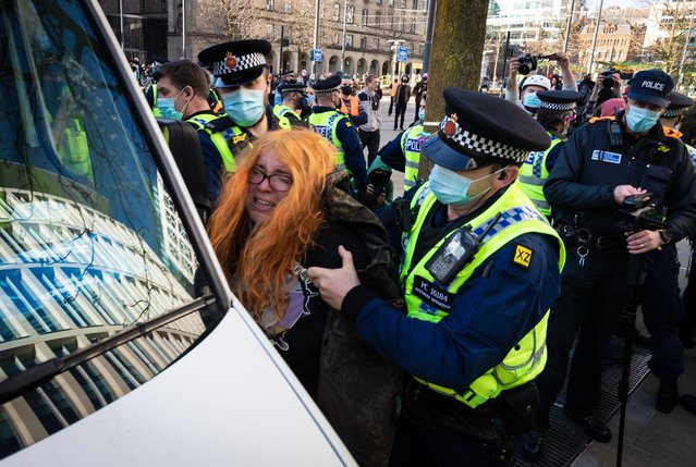 A protester is being detained by police during the demonstration in Manchester, United Kingdom on April 3, 2021. Protests continue throughout the country due to the proposed Police, Crime and Sentencing Bill that, if passed, would introduce new legislation around protesting. (Photo by Andy Barton/SOPA Images/Rex Features/Shutterstock)