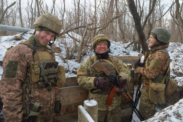 Ukrainian service members react while standing at fighting positions on the contact line with Russian-backed separatist rebels near the town of Avdiivka in Donetsk Region, Ukraine on February 13, 2021. (Photo by Oleksandr Klymenko/Reuters)