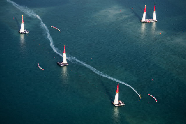 In this photo provided by Predrag Vuckovic via Global-Newsroom, Matt hall of Australia performs performs during the finals of the first stage of the Red Bull Air Race World Championship in Abu Dhabi, United Arab Emirates, Saturday, February 14, 2015. (Photo by Predrag Vuckovic/AP Photo/Global-Newsroom)