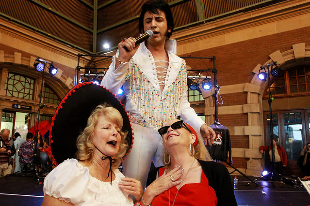 A Elvis tribute artist performs at Central Station prior to boarding the 'Elvis Express' on January 7, 2016 in Sydney, Australia. The Parkes Elvis Festival is held annually over five days, timed to coincide with Elvis Priestly's birth date in January. (Photo by Lisa Maree Williams/Getty Images)