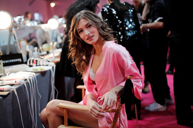 Model Grace Elizabeth gets ready backstage before the Victoria's Secret Fashion Show at the Grand Palais in Paris, France, November 30, 2016. (Photo by Benoit Tessier/Reuters)