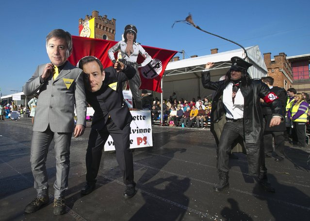 Revellers dressed as Belgian politicians Jan Jambon (L) and Bart De Wever (C) of the Flemish right-wing party (N-VA) take part in the 87th carnival parade of Aalst February 15, 2015. (Photo by Yves Herman/Reuters)