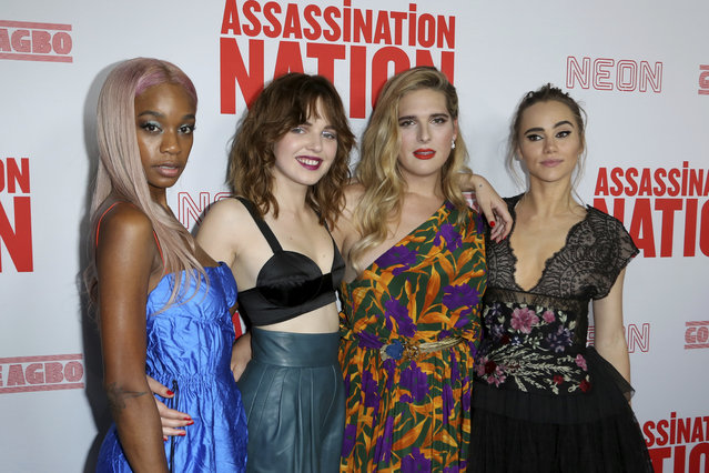 """Abra, from left, Odessa Young, Hari Nef and Suki Waterhouse, members of the cast, arrive at the LA Premiere of """"Assassination Nation"""" at the Arclight Hollywood on Wednesday, September 12, 2018, in Los Angeles. (Photo by Willy Sanjuan/Invision/AP Photo)"""