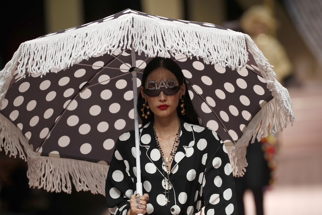 A model wears a creation as part of the Dolce & Gabbana women's 2019 Spring-Summer collection, unveiled during the Fashion Week in Milan, Italy, Sunday, September 23, 2018. (Photo by Antonio Calanni/AP Photo)