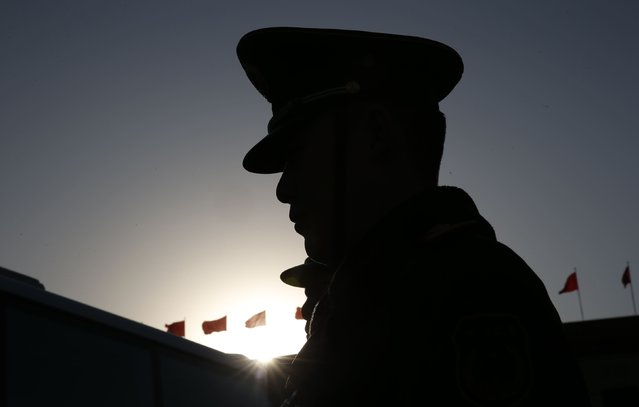 A paramilitary policeman stands guard outside the Great Hall of the People after the opening session of Chinese People's Political Consultative Conference (CPPCC) at Tiananmen Square in Beijing March 3, 2015.  REUTERS/Kim Kyung-Hoon