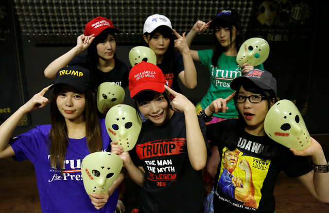 Members of Japanese idol group Kamen Joshi (Masked Girls) in attires featuring images or names of U.S. President-elect Donald Trump, pose for a photo after a rehearsal for a concert at their theatre in Tokyo's Akihabara district, Japan, December 12, 2016. (Photo by Toru Hanai/Reuters)