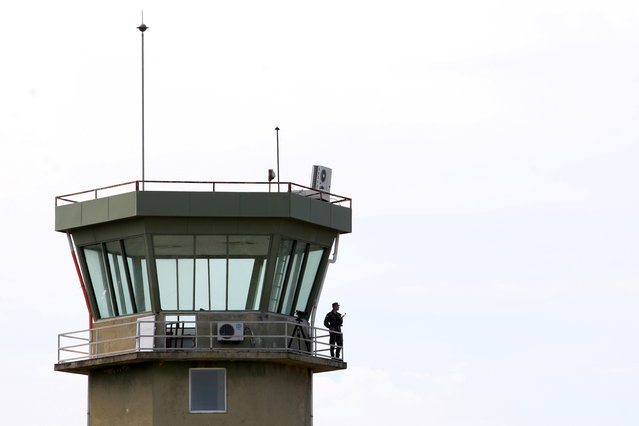 """An Albanian military member is pictured at the air traffic control tower in Kucova Air Base in Kucova, Albania on October 3, 2018. """"A NATO base there will boost the country's defense capacities, and foreign investors will have more confidence in Albania. It will also be good for employment in the area,"""" said 68-year-old retired air force commander Klement Alikaj. (Photo by Florion Goga/Reuters)"""