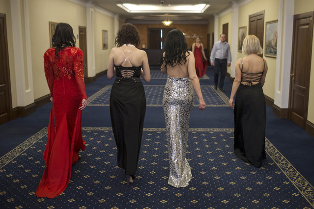 Female soldiers of the self-proclaimed Donetsk People's Republic walk backstage during a beauty pageant to mark International Women's Day in Donetsk, March 7, 2015. (Photo by Marko Djurica/Reuters)
