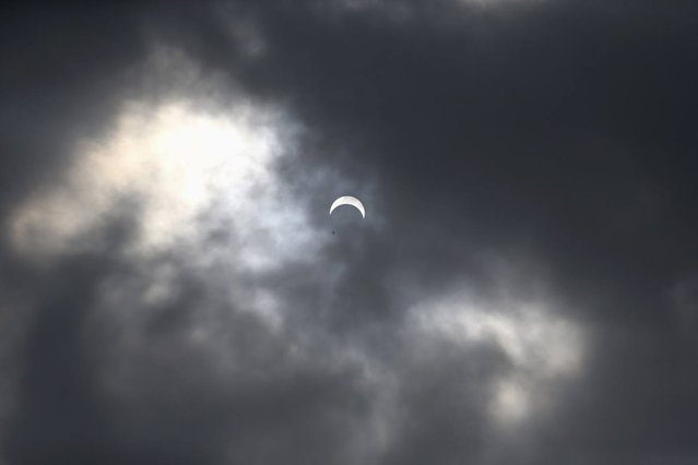 The sun is partially eclipsed in Lagos November 3, 2013. Skywatchers across the world are in for a treat Sunday as the final solar eclipse of 2013 takes on a rare hybrid form. (Photo by Akintunde Akinleye/Reuters)