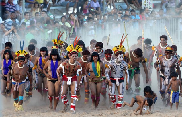 Members of Brazilian indigenous group Kuikuro dance during the XII Games of the Indigenous People in Cuiaba November 10, 2013. (Photo by Paulo Whitaker/Reuters)