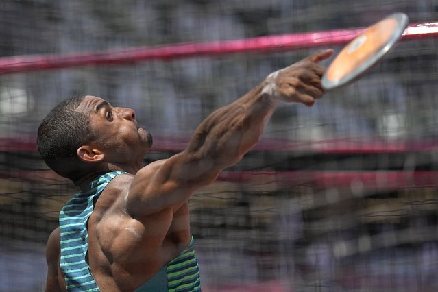 Felipe Dos Santos, of Brazil, competes in the decathlon discus throw at the 2020 Summer Olympics, Thursday, August 5, 2021, in Tokyo. (Photo by David J. Phillip/AP Photo)