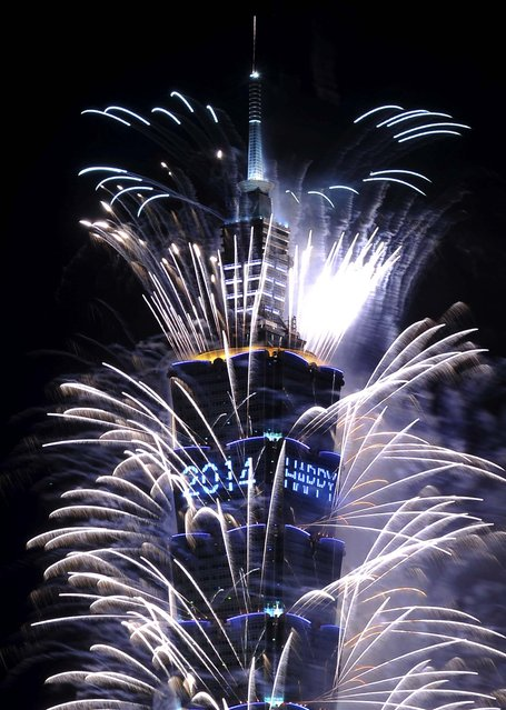 Fireworks explode from Taiwan's tallest skyscraper, the Taipei 101 tower. (Photo by Edward Lau/Reuters)