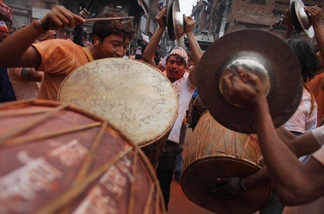 Nepalese devotees play traditional drums  during Sindur Jatra festival in Thimi, outskirts of Kathmandu, Nepal, Wednesday, April 15, 2015. (Photo by Niranjan Shrestha/AP Photo)