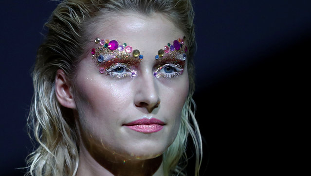 A model presents a makeup creation by Maybelline New York ahead of the Berlin Fashion Week Autumn/Winter 2017 in Berlin, Germany, January 16, 2017. (Photo by Fabrizio Bensch/Reuters)
