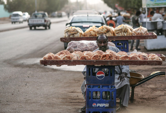 In this Saturday, April 11, 2015 photo, a bread seller waits for customers in Omdurman, Sudan. Nearly 13 million people are registered to vote for president and the 450-member legislative council starting Monday. Some 11,000 polling centers will be open through Wednesday, and results are expected on April 27. (Photo by Mosa'ab Elshamy/AP Photo)