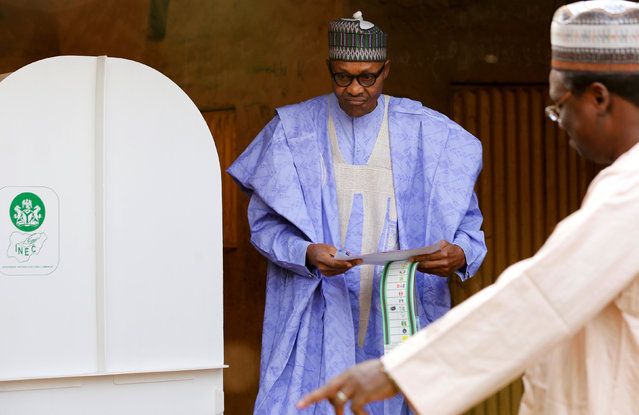 Nigerian President Muhammadu Buhari casts his vote in Nigeria's presidential election at a polling station in Daura, Katsina State, Nigeria, February 23, 2019. (Photo by Afolabi Sotunde/Reuters)