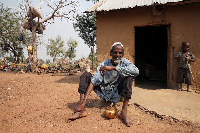 A man, displaced from southern Kaduna due to the fighting, sits in front of his new home in Kaduna, Nigeria January 9, 2017. (Photo by Afolabi Sotunde/Reuters)