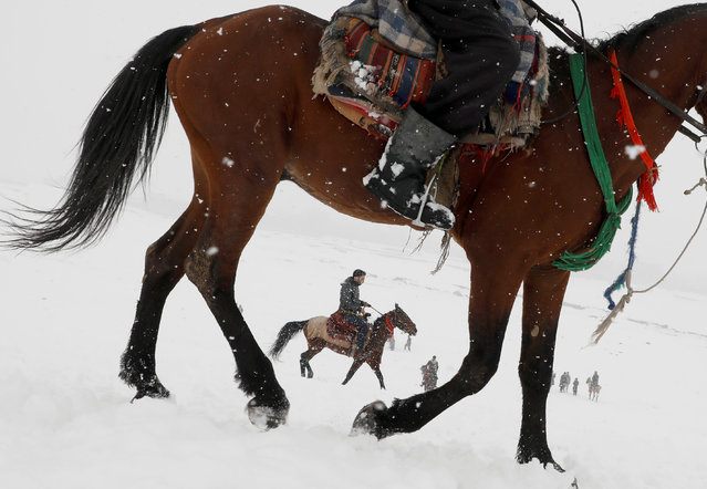 Afghan men ride horses on the snow-covered ground on the outskirts of Kabul, Afghanistan on February 17, 2019. (Photo by Omar Sobhani/Reuters)