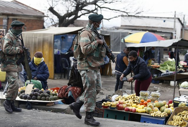 South African Defence Force soldiers on patrol in Alexandra Township, north of Johannesburg, Thursday, July 15 2021. The arm has begun deploying 25,000 troops to assist police in quelling the weeklong riots and violence sparked by the imprisonment of former President Jacob Zuma. (AP Photo)