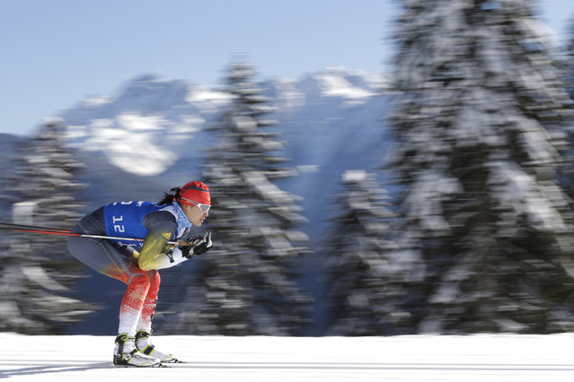 China's biathlete Tang Jialin trains at Laura Cross-country Ski & Biathlon Center ahead of the 2014 Winter Olympics, Monday, Feb. 3, 2014, in Krasnaya Polyana, Russia. (Photo by Felipe Dana/AP Photo)