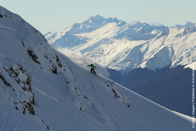Freerider Roland Morely- Brown of New Zealand rides down a ridge during the World Heli Challenge freestyle day in backcountry at Minaret Station on July 31, 2011 in Wanaka, New Zealand
