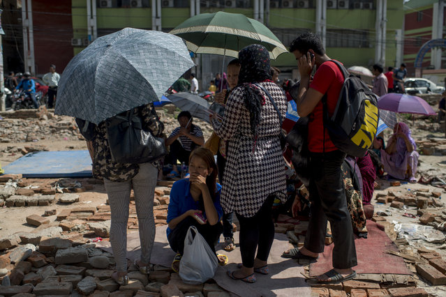 People gather in the safety of open space following a further major earthquake on May 12, 2015 in Kathmandu, Nepal. (Photo by Jonas Gratzer/Getty Images)
