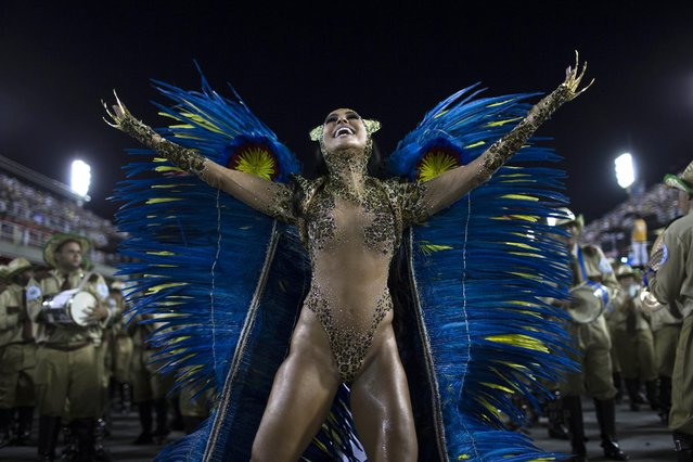 Drum Queen Sabrina Sato from the Vila Isabel samba school parades during carnival celebrations at the Sambadrome in Rio de Janeiro, Brazil, Tuesday, March 4, 2014. Brazil's Carnival is maintaining its frenetic pace, with hundreds of roving parties taking over Rio de Janeiro's streets and famed samba school parades heading into their final night. (Photo by Felipe Dana/AP Photo)