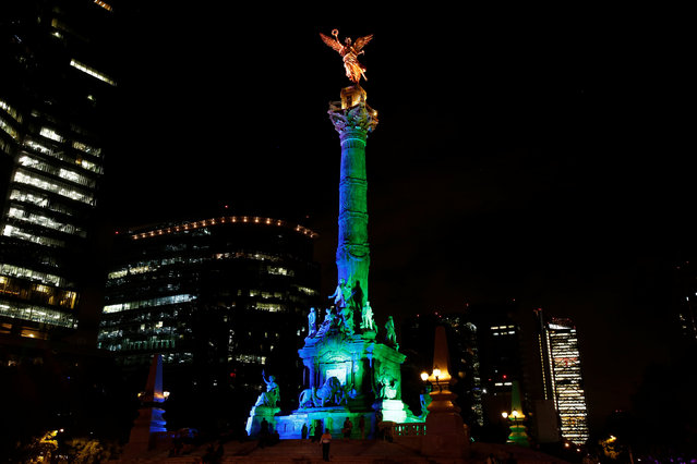 "The ""Angel de la Independencia"" monument is seen lit in the colours of Brazil's flag in homage to 2016 Rio Olympics, in Mexico City, Mexico, August 4, 2016. (Photo by Ginnette Riquelme/Reuters)"