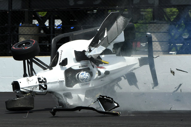 The car driven by Kyle Kaiser goes airborne after hitting the wall along the third turn during practice for the Indianapolis 500 IndyCar auto race at Indianapolis Motor Speedway, Friday, May 17, 2019 in Indianapolis. (Photo by Tom Pyle/AP Photo)
