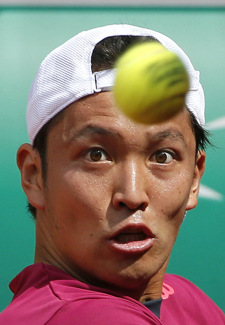 Japan's Tatsuma Ito eyes the ball as he prepares to play a shot to Fabio Fognini of Italy during their men's singles match at the French Open tennis tournament at the Roland Garros stadium in Paris, France, May 25, 2015. (Photo by Gonzalo Fuentes/Reuters)