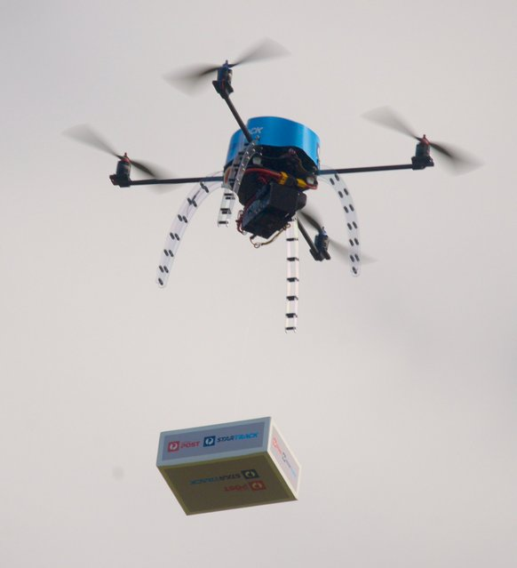 An Australia Post drone is pictured during trials of delivering packages from the air in this handout picture taken in Melbourne, Australia, April 15, 2016. Australia Post has successfully field-trialled the use of drones to deliver small packages, clearing the way for test deliveries to customer homes later this year. (Photo by Reuters/Australia Post)