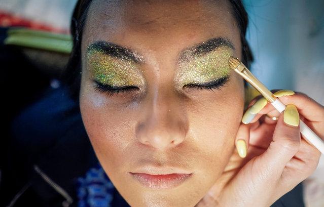 A model has her make up done backstage during Kazakhstan Fashion Week in Almaty, Kazakhstan, April 21, 2016. (Photo by Shamil Zhumatov/Reuters)