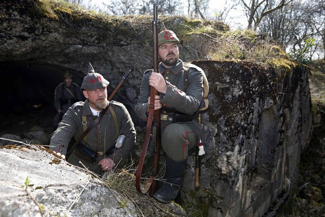 Members of German World War I historical association stand in front of a bunker at Bezonvaux. (Photo by Charles Platiau/Reuters)