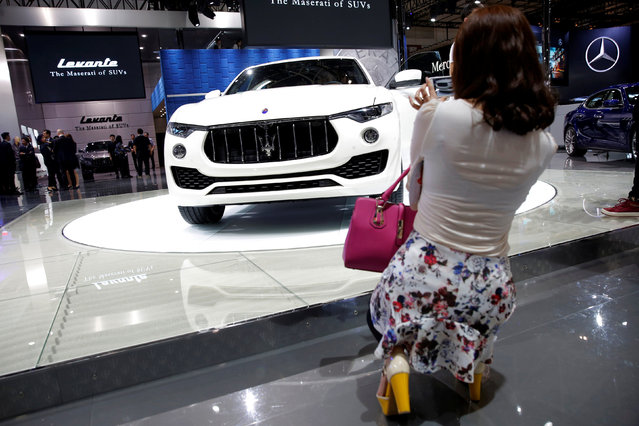A woman takes a picture of a Maserati's SUV model Levante during the Auto China 2016 show in Beijing, China April 25, 2016. (Photo by Kim Kyung-Hoon/Reuters)