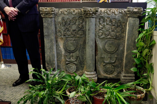 A second century C.E. Buddhist sculpture is displayed during a news conference in the office of the Manhattan District Attorney, in New York, Wednesday, April 27, 2016. Prosecutors returned the sculpture to the government of Pakistan after a Japanese antiquities dealer pleaded guilty to smuggling it into the U.S. The 70-year-old art dealer said he was motivated partly by a desire to protect Buddhist art from being neglected or destroyed in Pakistan. (Photo by Richard Drew/AP Photo)