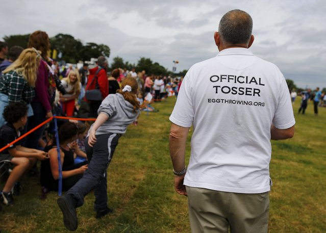 An organiser watches competitors during the World Egg Throwing Championships and Vintage Day in Swaton, Britain June 28, 2015. (Photo by Darren Staples/Reuters)