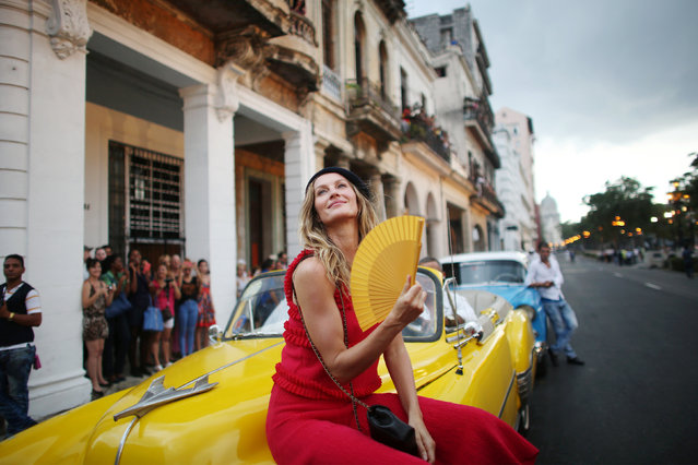Brazilian top model Gisele Bundchen poses before a fashion show by German designer Karl Lagerfeld as part of his latest inter-seasonal Cruise collection for fashion house Chanel at the Paseo del Prado street in Havana, Cuba, May 3, 2016. (Photo by Alexandre Meneghini/Reuters)