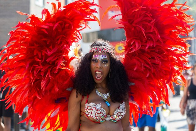 A performer in costume takes part in the carnival on the main Parade day of the Notting Hill Carnival in west London on August 26, 2019. (Photo by South West News Service)