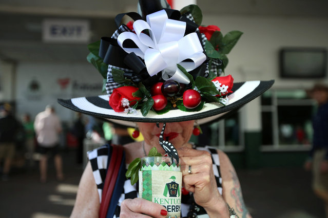 May 7, 2016; Louisville, KY, USA; Jan Baty enjoys a mint julep before the 142nd running of the Kentucky Derby at Churchill Downs. (Photo by Kramer Caswell/Louisville Courier-Journal via USA Today Network)