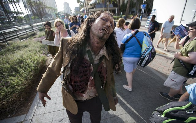 A person dressed like a zombie walks during the 2015 Comic-Con International Convention in San Diego, California July 9, 2015. (Photo by Mario Anzuoni/Reuters)