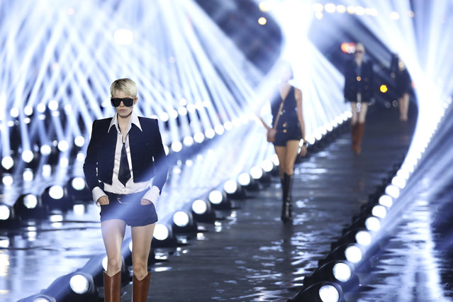 Models wear creations as part of the Saint Laurent Ready To Wear Spring-Summer 2020 collection, unveiled during the fashion week, in Paris, Tuesday, September 24, 2019. (Photo by Vianney Le Caer/Invision/AP Photo)