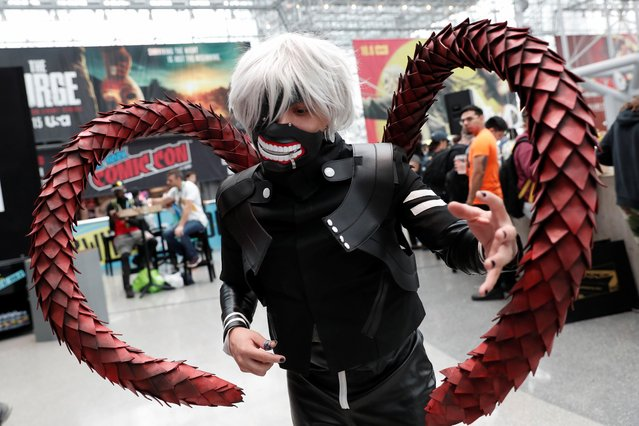 A person dressed in costume poses for a photograph at the 2019 New York Comic Con in New York City, New York, U.S., October 3, 2019. (Photo by Shannon Stapleton/Reuters)