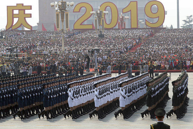Members of a Chinese military honor guard march during the the celebration to commemorate the 70th anniversary of the founding of Communist China in Beijing, Tuesday, October 1, 2019. (Photo by Ng Han Guan/AP Photo)
