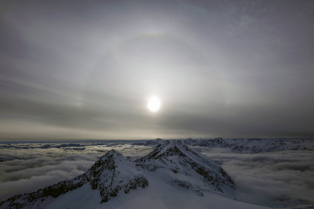 A halo, an optical phenomena from sunlight and ice crystals, rises above Goldberg group mountains, seen from Sonnblick summit at 3,106 meters above sea level, in the Hohe Tauern mountain range near Rauris, Austria, November 23, 2018. (Photo by Lisi Niesner/Reuters)
