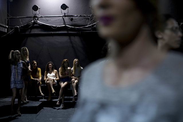In this Tuesday, May 24, 2016 photo, contestants in the first Miss Trans Israel beauty pageant, practice the walk on the stage during rehearsal in Tel Aviv, Israel. (Photo by Oded Balilty/AP Photo)